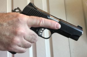 gun with finger off trigger