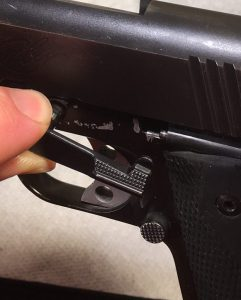 Inserting the slide lock lever Kimber 1911