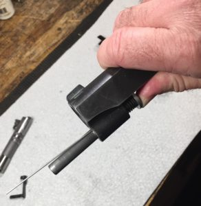 How and When to Replace the Recoil Spring on a Kimber Pro Carry 1911- Place the take down tool into the hole in the guide rod