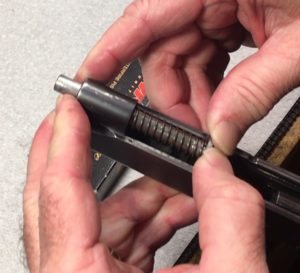 How and When to Replace the Recoil Spring on a Kimber Pro Carry 1911- Push the Guide rod until the hole is visible