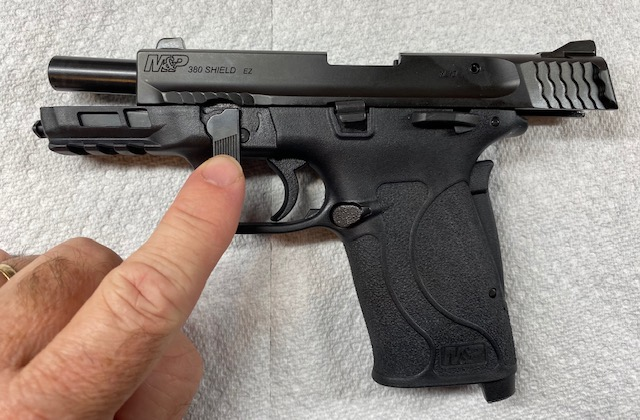 Shield 380. Rotate the Take-down Lever to the 6 o'clock Position
