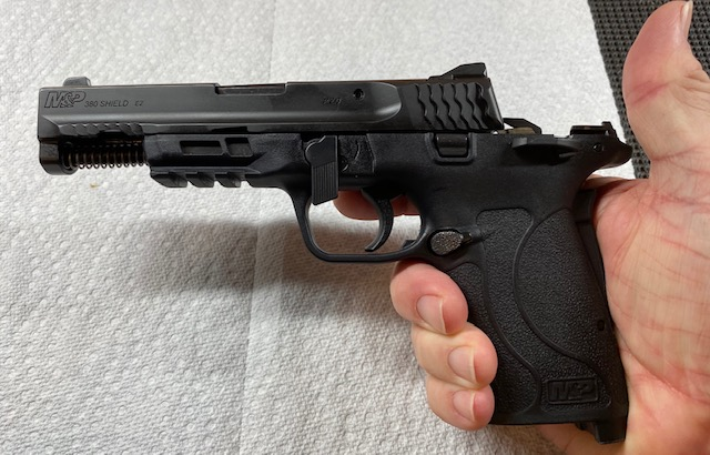 Shield 380. remove the Slide by Slowly Pulling off the Front of the Gun