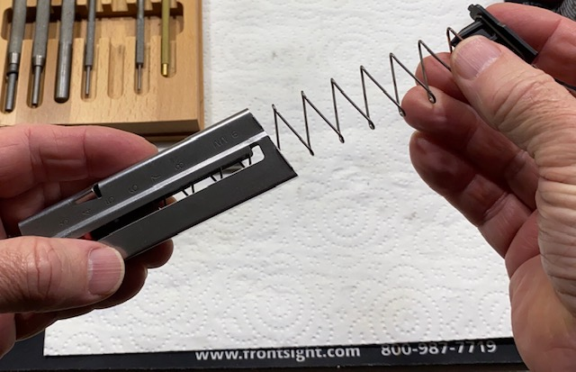 Remove the spring from the magazine tube.