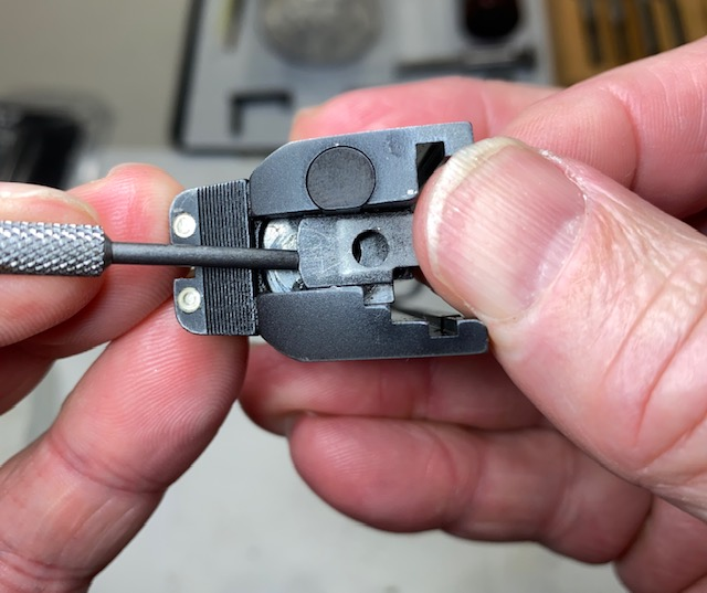 Use the punch to push the firing pin stop out of the slot